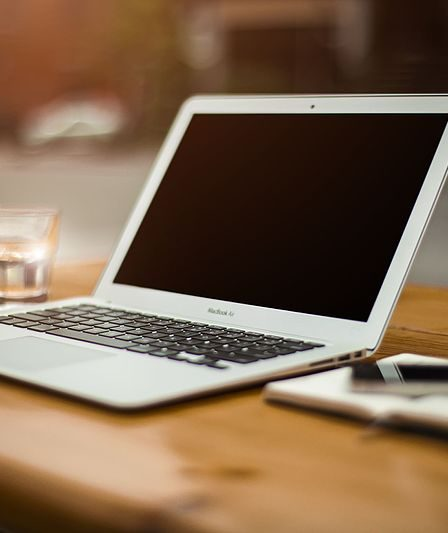 laptop in the table. sponsored post networks for bloggers